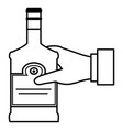 hand with whiskey bottle drink vector image