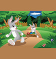 rabbits pulling an easter egg cart vector image vector image