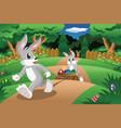 rabbits pulling an easter egg cart vector image