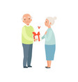 senior man giving woman a present elderly vector image vector image