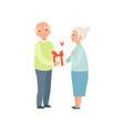 senior man giving woman a present elderly vector image vector image