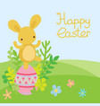 easter bunny and egg in field vector image vector image
