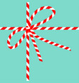 red white ribbon bow knot on blue background vector image vector image