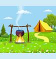 black camping pot over a bonfire vector image vector image