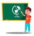 schoolboy writes chalk on a school board vector image vector image