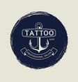 vintage tattoo salon emblem with anchor vector image