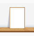 frame with poster mockup standing on wooden vector image