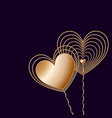 two golden wire hearts on dark background vector image vector image