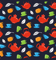 seamless pattern with teapot and tea cups on black vector image vector image
