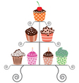 vector set of various cupcakes on a stand vector image
