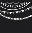 Decorative garlands over chalkboard background