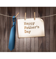 Happy Fathers Day background with a blue tie on a vector image