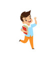 smiling little boy jumping with book cute kid vector image vector image
