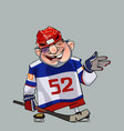 comical cartoon hockey player with a stick vector image vector image