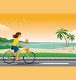 girl riding bicycle at beach vector image