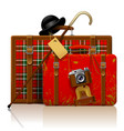 red old suitcases with walking stick bowler hat vector image