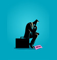 businessman sitting on suitcase sadly vector image vector image