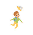 happy boy jumping with book cute kid playing and vector image vector image