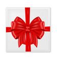 gift box wrapped with red ribbon with silk bow vector image