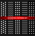 set of white geometric pattern on black background vector image vector image