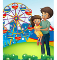 A father with his daughter at the carnival vector image vector image