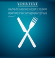 crossed fork and knife icon on blue background vector image vector image
