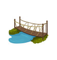 timber bridge with rope railings small wooden vector image vector image