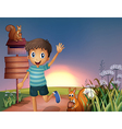 A happy young boy at the hilltop with squirrels vector image vector image