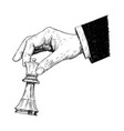 artistic drawing of hand holding chess king figure vector image vector image