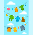 baby clothes hanging on ropes with clothespins vector image vector image