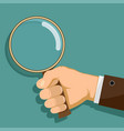 man is holding a magnifying glass in his hand vector image vector image