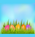 row of decorated easter eggs hiding in grass on vector image vector image