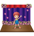 A stage with a young boy waving happily vector image vector image