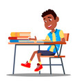little pupil at a desk reading book in the vector image vector image