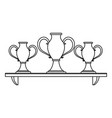 trophy cups on shelf in black and white vector image vector image