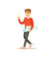 young smiling male student walking with paper vector image vector image