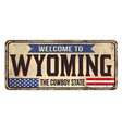 welcome to wyoming vintage rusty metal sign vector image vector image