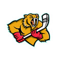 saber toothed cat ice hockey mascot vector image vector image