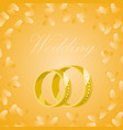 golden wedding rings on yellow background vector image vector image