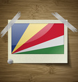 Flags SEYCHELLES at frame on wooden texture vector image