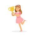 happy school girl in pink dress holding winner cup vector image vector image