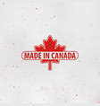 made in canada emblem maple leaf red stamp vector image