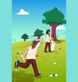 teens picking up trash in the park vector image