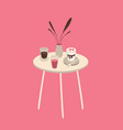 white table with cups with drinks and desserts on vector image vector image