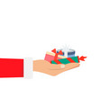 hand of santa claus holding a big stack many vector image