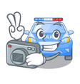 photographer miniature cartoon police car on table vector image vector image