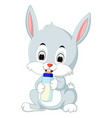 cartoon cute bunny holding bottle milk with nipple vector image