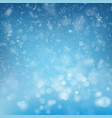 blurred bokeh light snowflakes on blue background vector image