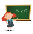 Smart girl presenting in front of blackboard vector image vector image