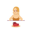 sad woman sitting at table and looking at cake vector image vector image